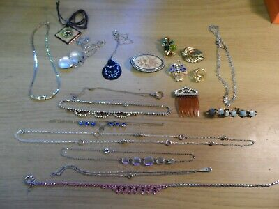 Collection of Costume Jewelry with Necklaces & Broaches