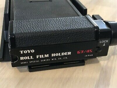 TOYO 67/ 45 roll film holder (6x7cm 6x7 back for 4x5 inch camera). Great cond.