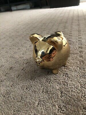 Gold piggy bank slightly used