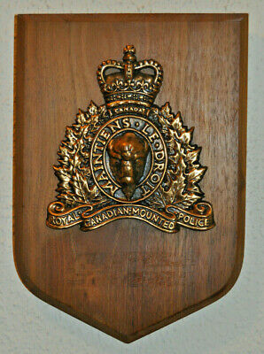 Large metal on wood Royal Canadian Mounted Police wall plaque shield RCMP