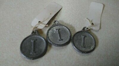 "Assorted Pendulum Clock Weights all marked with ""I"" Ingrahm Clock Co."