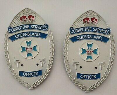 38)  2 X Corrective Services Qld Officer Badges