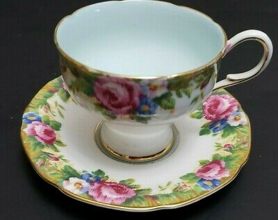 "Paragon Footed Cup And Saucer ""Tapestry Rose"" Gilt Pink Roses Blue Ground Inside"