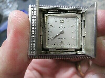 VINTAGE ART DECO silver CYMA PUSH OPEN RUNNING TRAVAL CLOCK 33 mm BY 49mm
