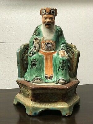 Old Chinese Figure On A Stand