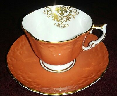 Aynsley Orange Teacup and Saucer Embossed Gold Guild Scalloped Edge