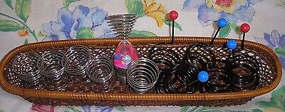 12 metal Egg Holders in Wicker Basket.