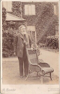Antique Cabinet Photo - Bearded Man In Garden With Wicker Chair .Manchester