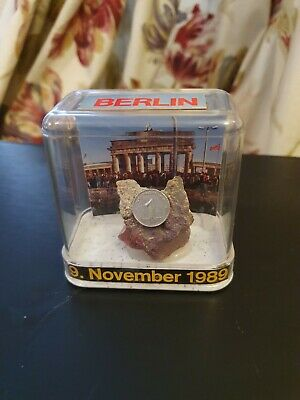 Genuine Berlin Wall pieces in presentation box with 1 pfennig coin .