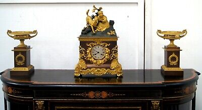 A gilt bronze and brown patinated 3 piece 19th century French clock set