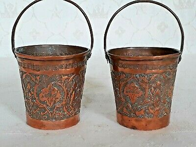 Two vintage miniature copper buckets with ornate design