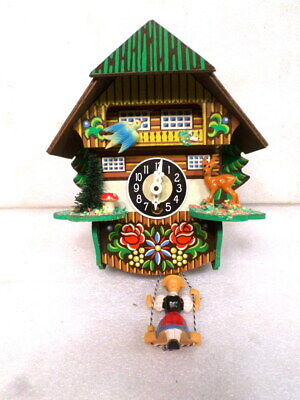 Unusual Colorful Bouncing Doll Cuckoo Clock--With Original Bouncing Doll