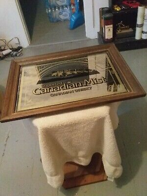 A Vintage important Canadian  Mist Canadian  Whisky Sign and  Mirror