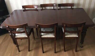 Antique Victorian extendable mahogany dining table with six chairs