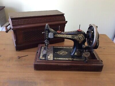 Vintage Antique Singer Sewing Machine with case.