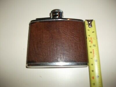 Hip flask,  4oz,  Stainless Steel,with buffalo  calf on out side , used