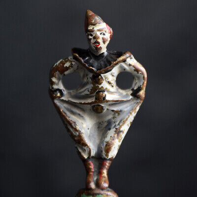 Pair of early 20th Century Brass hands painted bottle top figure