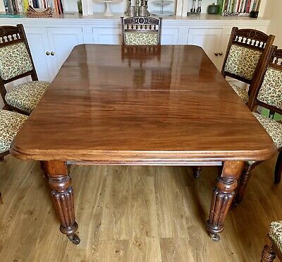 Antique Victorian Mahogany(?) extending dining table, carved legs, castors.