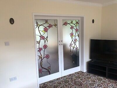 Double doors with large stained glass panels
