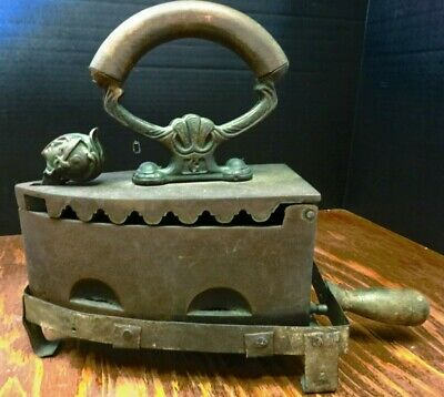 Antique Cast Iron Warrior Head Coal Clothes Iron & Stand Wood Handles