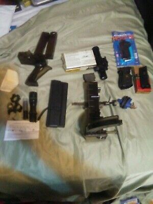 junk drawer lot#no junk-gun lot pistal grips/sopes/speed loaders/other great s