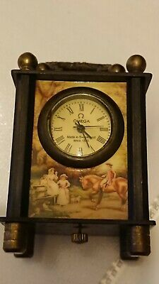 Rare Omega miniature Swiss carriage clock and case, in working order.
