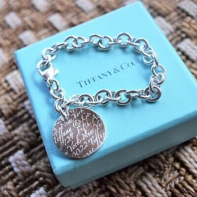Authentic Tiffany & Co. Notes Sterling Silver Charm Bracelet