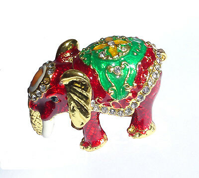 Elephant   Metal gold-colored with enamel rhinestones hidden compartment    ME11