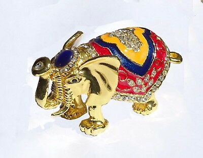 Elephant   Metal gold-colored with enamel rhinestones hidden compartment    ME31