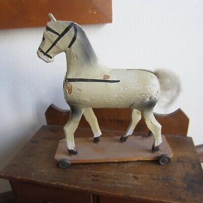 antique early american primitive wooden toy horse on tin wheels handmade
