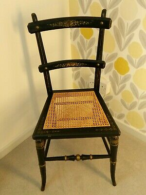 Antique decorative, ebonised bedroom/dining chair with cane seat.