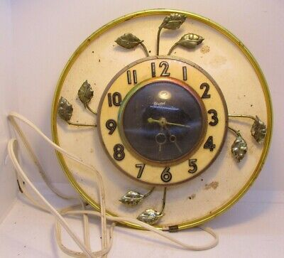 Working Vintage United Wall Clock with Metal Gold Leaf Design Electric