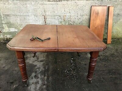 Victorian extending mahogany dining table 2 extension leaves winding handle