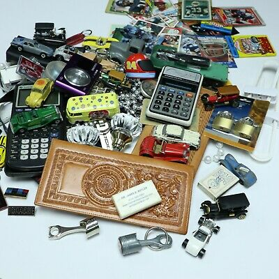 JUNK DRAWER LOT Mixed toy cars, sports cards, camera