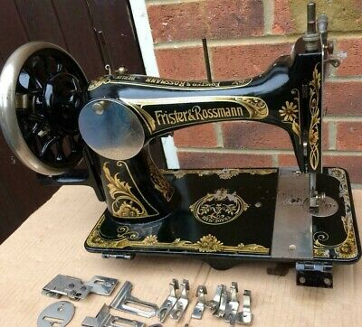 Vintage Frister & Rossmann Hand Crank sewing machine with attachments.