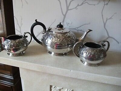 CIVIC SILVER PLATED REPOUSSE 3 PIECE TEASET - Early 20th century