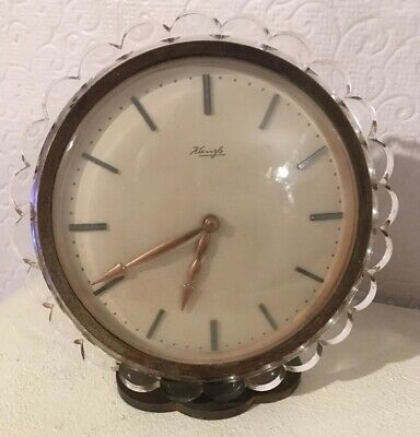 Kienzle 8 Day Table Clock was designed by Heinrich Johannes Möller in the 1940s.