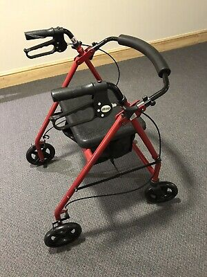 Red wheeled walker/rollator by Drive. Model R8RD59. padded seat. Lightly used
