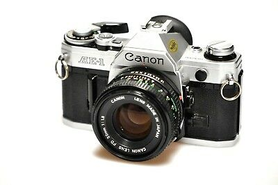 Canon AE-1 35mm SLR Film Camera with FD 50 mm lens Kit PERFECT WORKING! CLA