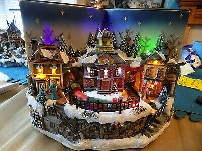 Santa Musical Lit Up Scene with Moving Train Christmas Decoration Boxed