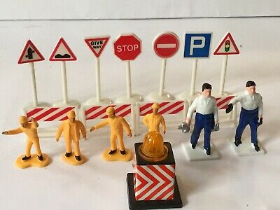 Roadway Signs,Barriers And Men.