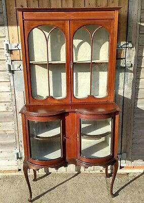 An Unusual Edwardian Mahogany Inlaid Double Bow Display Cabinet..