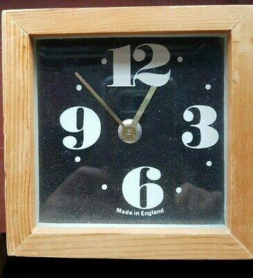 Lovely 1970's Vintage Clock. Clockwork movement in wooden case and black face.