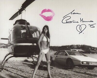 007 Bond girl Caroline Munro signed and kissed Bond car bikini photo