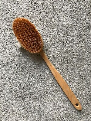Natural bristle and wood body brush