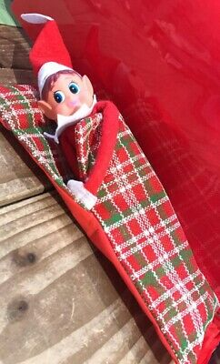 NAUGHTY ELF ACCESSORIES PROPS ON THE SHELF. Sleeping bag