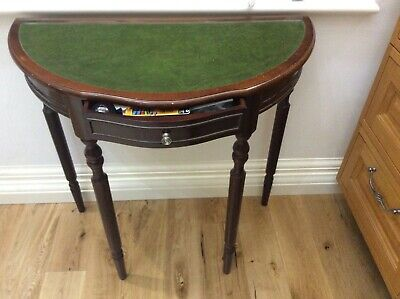 Mahogany Half moon table with leather inlaid top and small draw