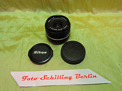 Nikon, Nikkor 2,8/28mm Serie E in normal condition, 2 caps