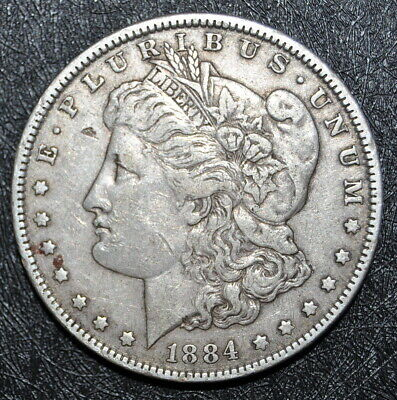 1884-P MORGAN SILVER DOLLAR an HONEST UNGRADED COIN with FREE U.S. SHIPPING !