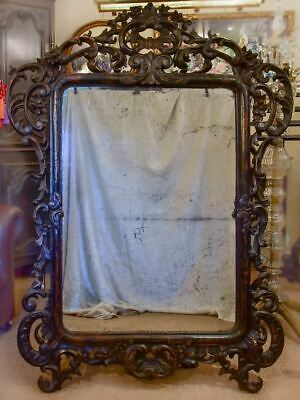 Large late 18th Century carved wood mirror with original black patina old glass